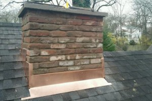 Photo #2: Gutter, re-roofs, new construction, chimneys, flashing