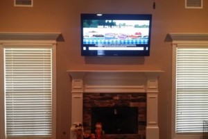 Photo #8: Tv's Mounted With No Wires Exposed!