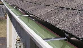 Photo #2: Gutters and gutter covers by Chris