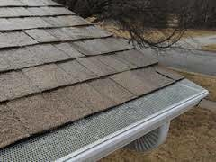 Photo #4: Gutters and gutter covers by Chris