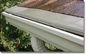 Photo #6: Gutters and gutter covers by Chris