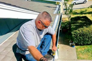Photo #9: ROOFTO $95.00 GUTTER CLEANING
