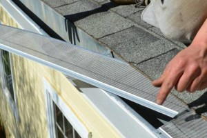 Photo #8: ROOFTO $95.00 GUTTER CLEANING