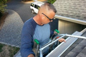 Photo #7: ROOFTO $95.00 GUTTER CLEANING