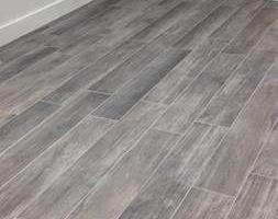 Photo #7: Install tile starting at 1.10sqft, laminate 1.15sqft...