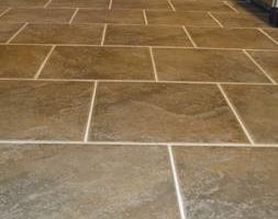 Photo #6: Install tile starting at 1.10sqft, laminate 1.15sqft...