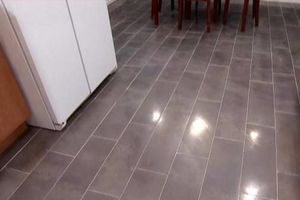 Photo #1: Install tile starting at 1.10sqft, laminate 1.15sqft...