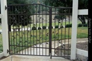 Photo #1: Need a fence? Stucco or welder?