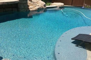 Photo #3: SWIMMING POOL REMODELING... TILE, COPING, PLASTER, ACID WASH, MASTIC