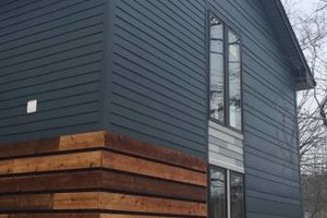 Photo #2: Siding, windows, gutters