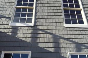 Photo #1: Siding, windows, gutters