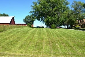 Photo #1: GRASS NEED CUTTING? Free Estimates