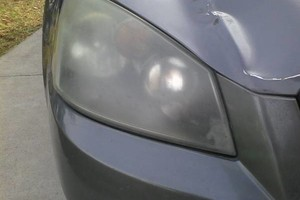 Photo #4: Headlight Foggy? Hard to see at night? Don't buy new headlight lenses