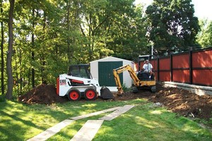 Photo #1: Demolition - from storage sheds to houses