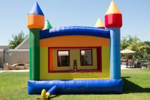 Photo #6: Bounce houses, mook walks, wedding tents, chairs.... Coco Pongo