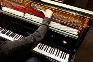 Photo #1: PIANO TUNING by OUR SEASONED PROFESSIONALS (Bill Kap Piano Co.)