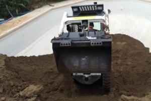 Photo #1: Backhoe ( excavation/Demo/pool abandonment)