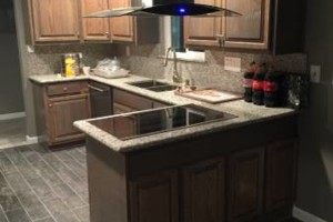 Photo #4: Junior custom construction. Kitchen cabinets & granite