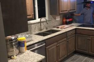 Photo #1: Junior custom construction. Kitchen cabinets & granite