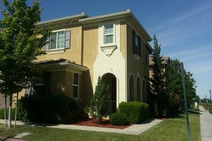 Photo #2: Low price to paint you home exterior! Call today!