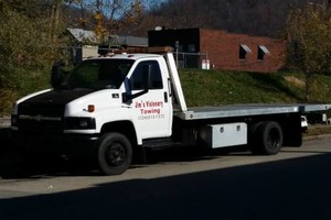 Photo #1: Jim's visionary. Affordable Towing 24/7!