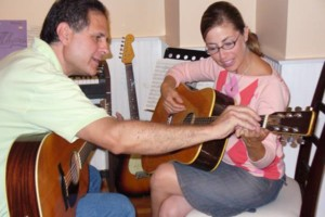 Photo #1: Experienced, patient guitar teacher Peter King gets results. Studio or your home!
