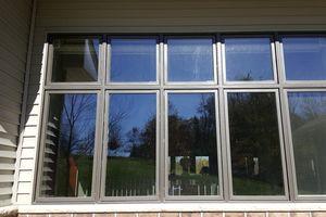 Photo #1: Elite Services - Gutter Services, Window Washing, Pressure Washers