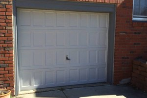 Photo #1: Precision Garage Door Repair. High Quality Service!