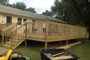 Photo #1: General Construction - decks, roofing, covered porches, window installation
