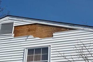 Photo #1: WIND SIDING/ROOF DAMAGE? Possible replacement 4 FREE