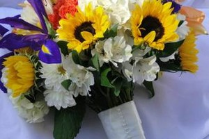 Photo #18: Petals On Park. Florist- Linens - glassware - vases