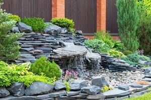 Photo #1: Unique Yardscapes Koi Ponds and Stonework