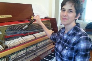 Photo #1: Expert Piano Tuner. You'll be happy to have in your home!