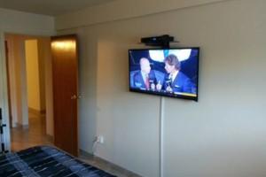 Photo #1: BROOKLYN TV GUYS. PROFESSIONAL TV Installation On Wall