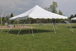 Photo #1: Rental tents , chairs , and tables , also bounce house