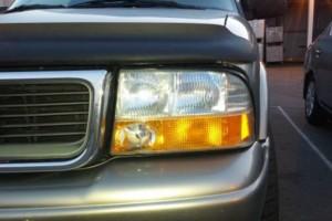 Photo #1: Dull and yellowing plastic Headlight repair plus
