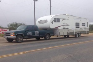 Photo #2: Rv, Motorhomes, trucks... We tow them all!