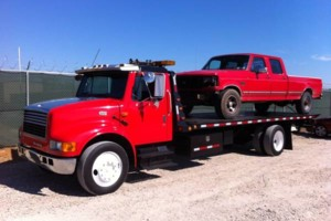 Photo #3: FLATBED - TOWING - ROLLBACK - WRECKER - SHED MOVING. GREAT PRICES!