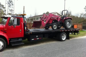 Photo #1: FLATBED - TOWING - ROLLBACK - WRECKER - SHED MOVING. GREAT PRICES!