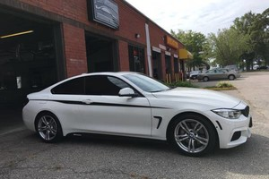 Photo #4: Get window tint today / best prices on window tinting!