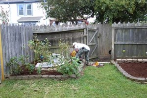 Photo #1: Men at the mission-yard work/painting