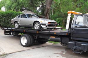 Photo #1: TOWING, FLAT RATE PRICING, QUICK and EASY