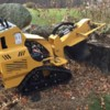 Logo Powers Outdoor Services. Stump Grinding