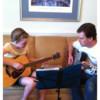 Logo Powerstrings LLC. Guitar Lessons