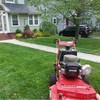 Logo First Class landscaping and lawn care