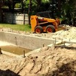 Grading, concrete removal, dirt work, etc
